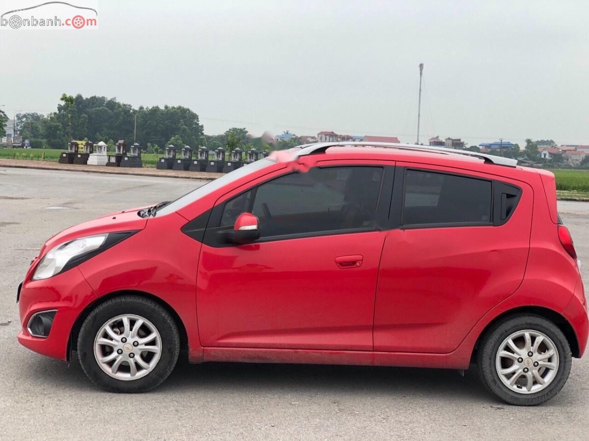 Cần bán lại xe Chevrolet Spark sản xuất 2014, màu đỏ