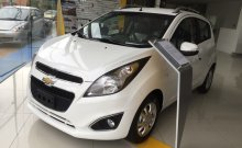 Cần bán Chevrolet Spark Zest đời 2015, màu trắng giá cạnh tranh giá 390 triệu tại Bình Dương