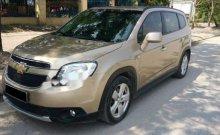 Cần bán xe Chevrolet Orlando đời 2012, màu vàng còn mới giá 397 triệu tại Tp.HCM