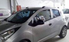 Cần bán Chevrolet Spark 1.2 LT 2012, màu bạc, xe đang chạy tốt giá 200 triệu tại Tp.HCM