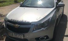 Cần bán gấp Chevrolet Cruze LS 1.6 MT 2010, màu bạc xe gia đình giá 310 triệu tại Long An