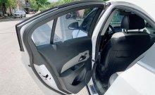Cần bán lại xe Chevrolet Cruze LT 1.6 MT sản xuất năm 2015, màu trắng   giá 395 triệu tại TT - Huế