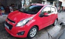 Cần bán xe Chevrolet Spark AT sản xuất năm 2014, màu đỏ  giá 245 triệu tại Tp.HCM