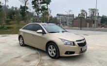Cần bán xe Chevrolet Cruze LS 1.6 MT đời 2013, màu vàng chính chủ giá 295 triệu tại Hòa Bình